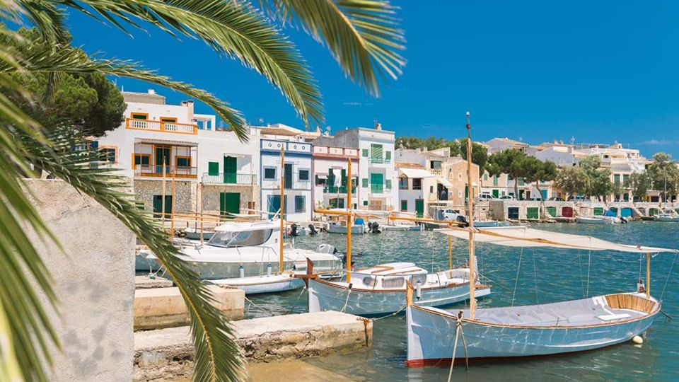 The small town of Portocolom is reminiscent of traditional Mallorca with its natural harbor and small fishing boats.
